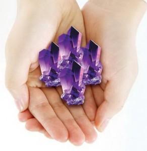 Amethyst Crystal Held in Hand